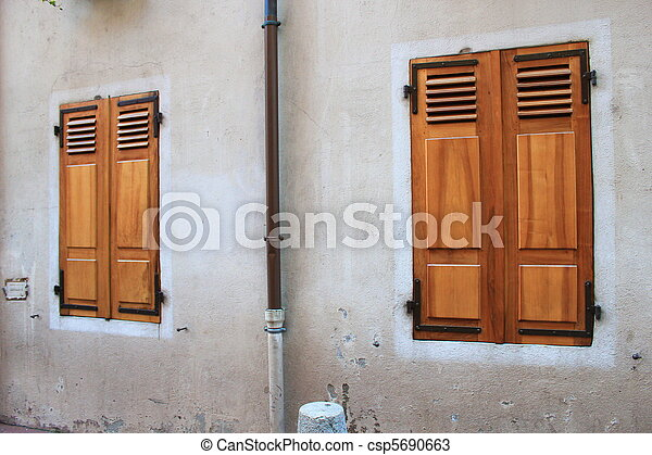 Closed wooden shutters - csp5690663