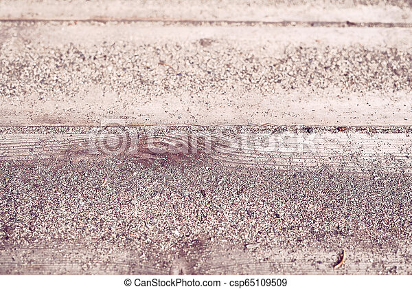 Closeup background detail of warm sand on wooden planks from a coastal summer resort beach patio - Concept of tropical vacation, seaside relaxation or coastline walk - csp65109509