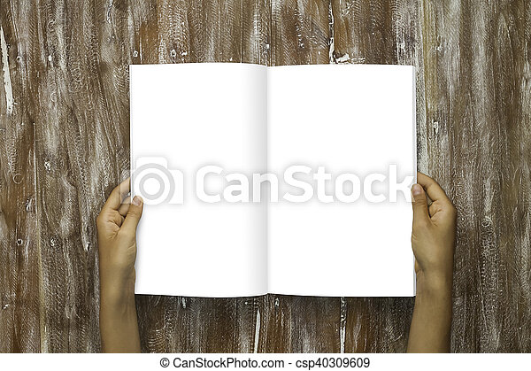Closeup Blank Open Book White Paper Sheet Holding Male Hands. Mockup Natural Wood Table Background. Empty Mock up Painted Brown Desk. - csp40309609