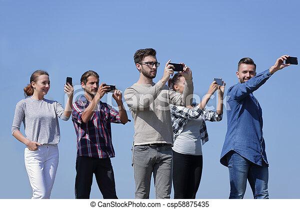 closeup. confident young people make selfies. - csp58875435