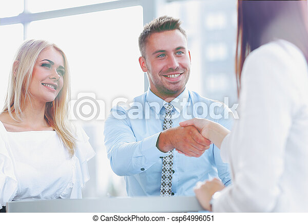 closeup. Manager shakes the hand of a woman client. - csp64996051