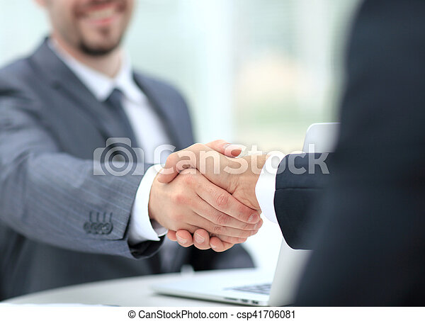 Closeup of a business handshake. Business people shaking hands, finishing up a meeting - csp41706081