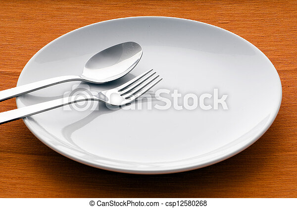 closeup of a place setting with dinner-plate - csp12580268