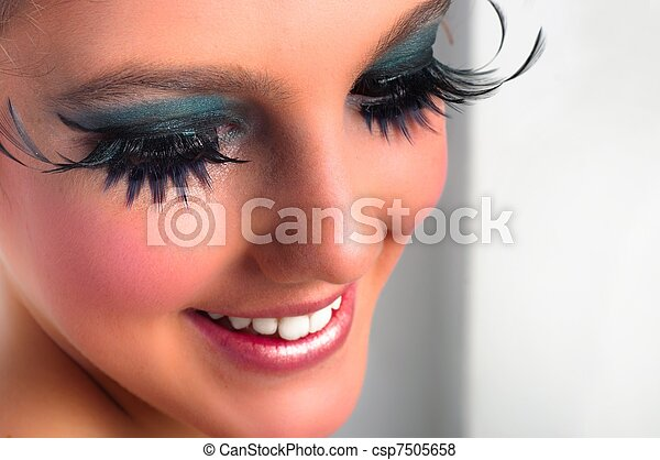 Closeup of a pretty girl with extreme makeup - csp7505658