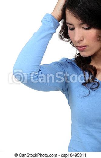 Closeup of a young woman looking sad - csp10495311