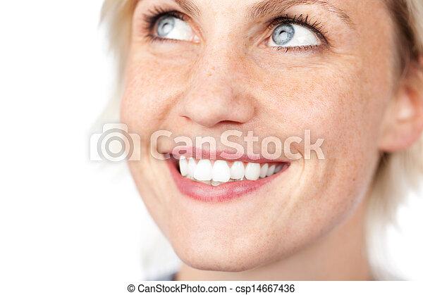 Closeup Of Beautiful Blue Eyed Woman Smiling - csp14667436