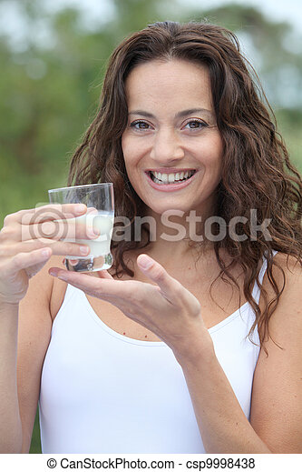 Closeup of beautiful woman drinking milk - csp9998438