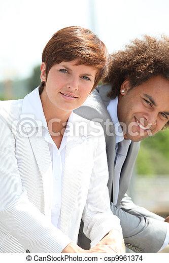 Closeup of business people - csp9961374