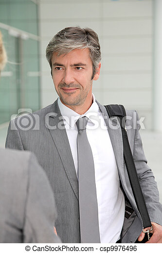 Closeup of businessman shaking hand to client - csp9976496