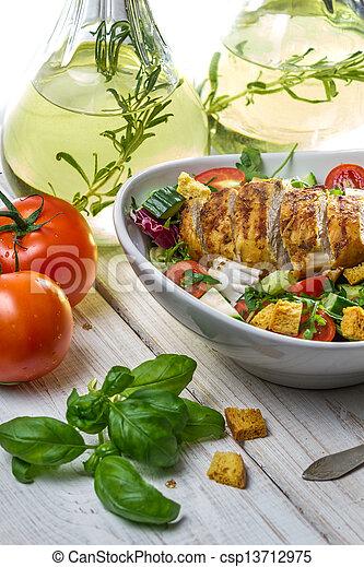 Closeup of Caesar Salad and fresh ingredients - csp13712975