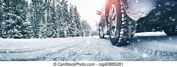 Closeup of car tires in winter on the road - csp63885281