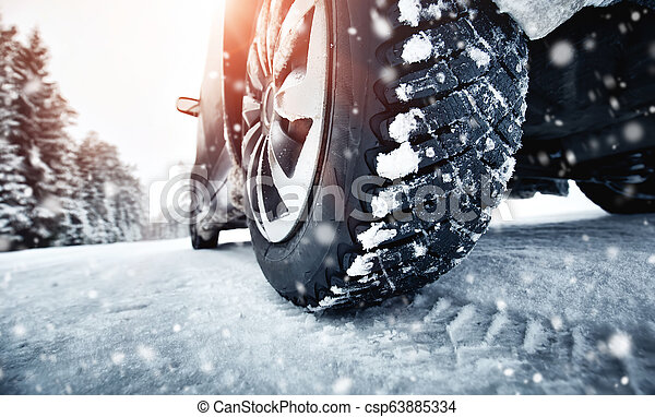 Closeup of car tires in winter on the road - csp63885334