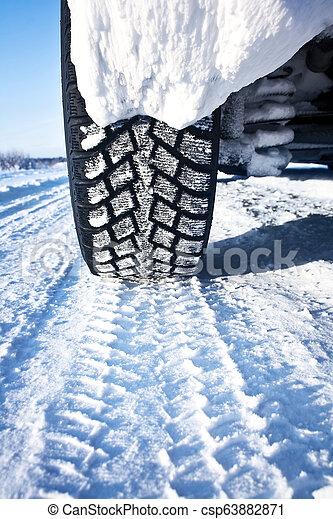 Closeup of car tires in winter - csp63882871