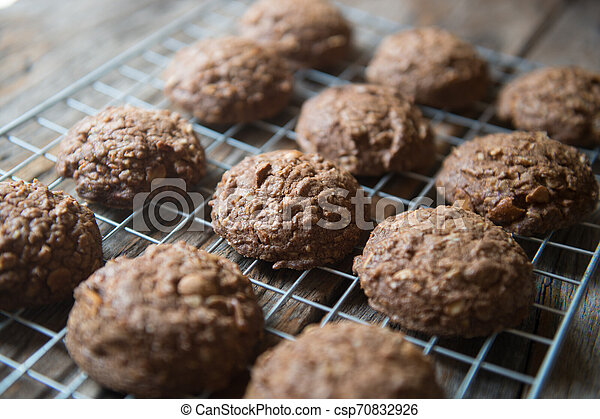 Closeup of chocolate cookie on a grate - csp70832926