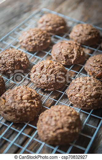 Closeup of chocolate cookie on a grate - csp70832927