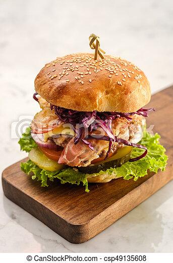 Closeup of classical homemade burger with bacon. - csp49135608