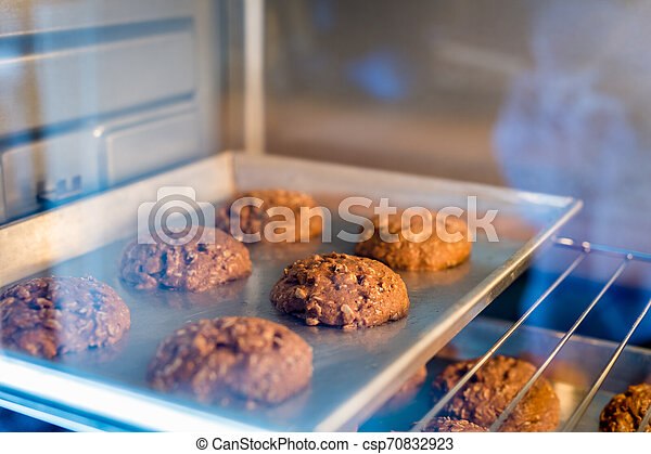 Closeup of cookie on tray in a oven - csp70832923
