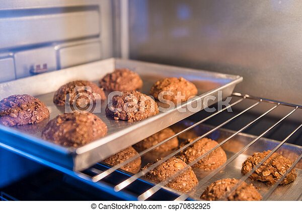 Closeup of cookie on tray in a oven - csp70832925