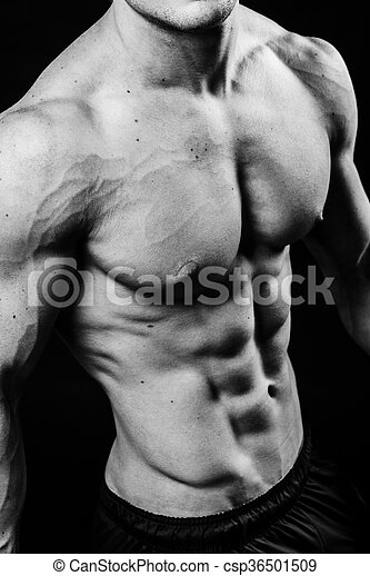 Closeup of cool perfect sexy strong sensual bare torso with abs pectorals 6 pack muscles chest black and white studio, vertical picture - csp36501509