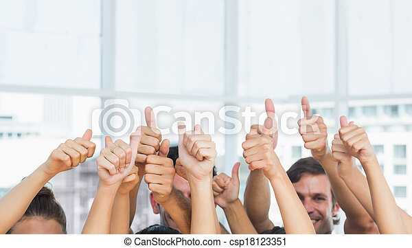 Closeup of cropped people gesturing thumbs up - csp18123351