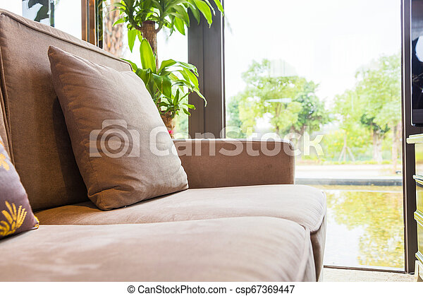 Closeup Of Cushion On Sofa By The Window In The Living Room At Home