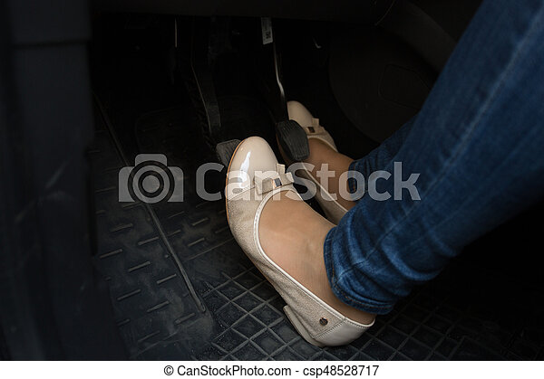 Closeup of female driver feet on car pedals - csp48528717