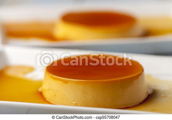 closeup of flan dessert on plates - csp55708047
