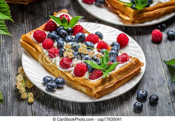 Closeup of fresh berry fruit on waffles - csp17635041