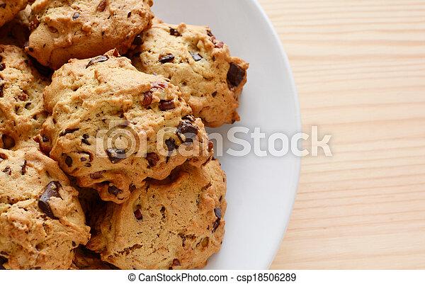 Closeup of fresh chocolate chip and pecan cookies - csp18506289