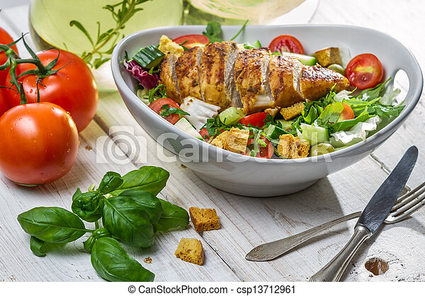 Closeup of healthy salad with chicken and ingredients - csp13712961