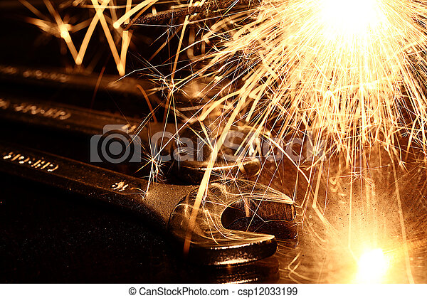 Closeup of iron spanners set and sparks - csp12033199