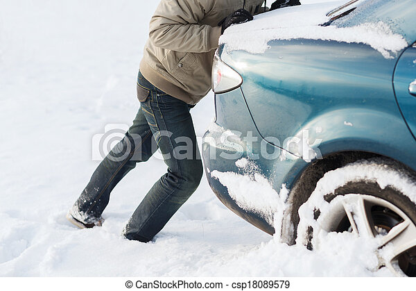 transportation winter and vehicle concept closeup of man pushing