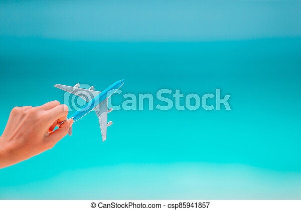 Closeup of map and model airplane background the sea - csp85941857