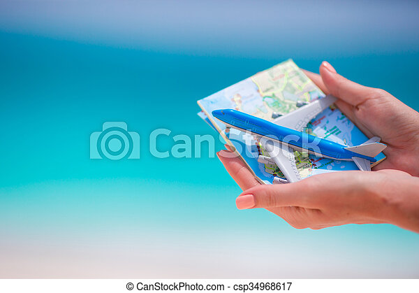 Closeup of map and toy airplane background the sea - csp34968617