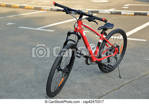 closeup of mountain bike at parking lot - csp42470317