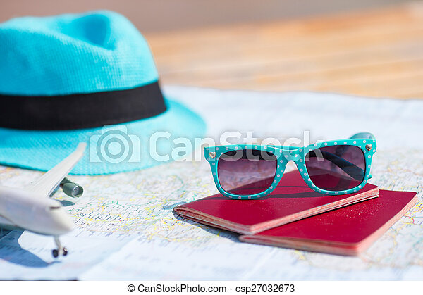 Closeup of passports, toy airplane, sunglasses on the map - csp27032673