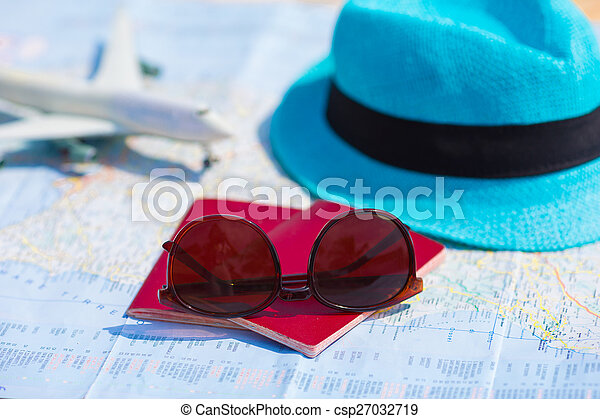 Closeup of passports, toy airplane, sunglasses on the map - csp27032719