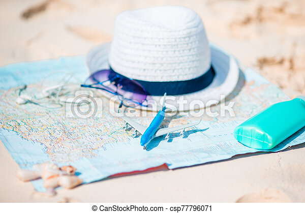Closeup of passports, toy airplane, sunglasses on the map - csp77796071