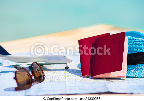 Closeup of passports, toy airplane, sunglasses on the map - csp31339086