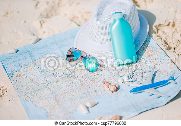 Closeup of passports, toy airplane, sunglasses on the map - csp77796082