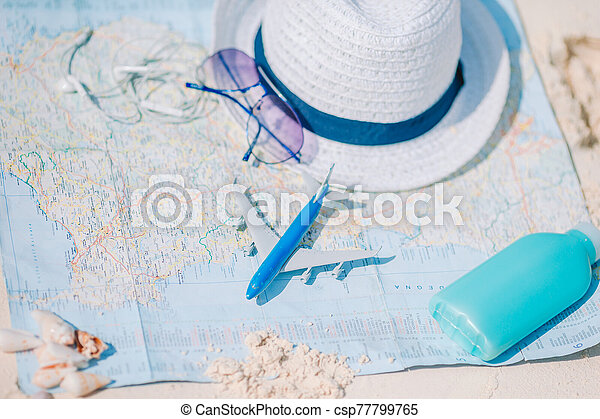 Closeup of passports, toy airplane, sunglasses on the map - csp77799765