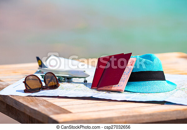 Closeup of passports, toy airplane, sunglasses on the map - csp27032656