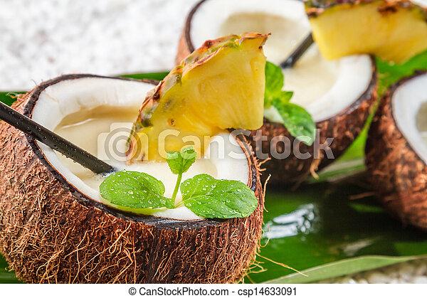 Closeup of pinacolada in a coconut - csp14633091