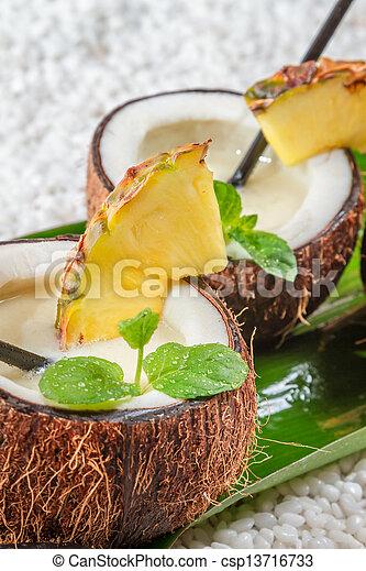Closeup of pinacolada in a coconut - csp13716733