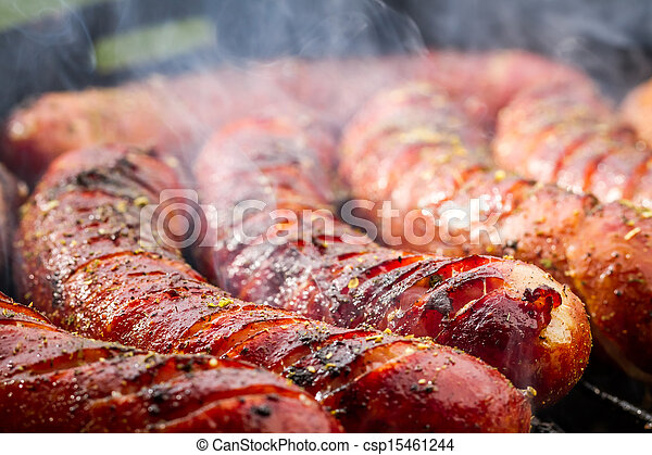 Closeup of sausage on the grill - csp15461244