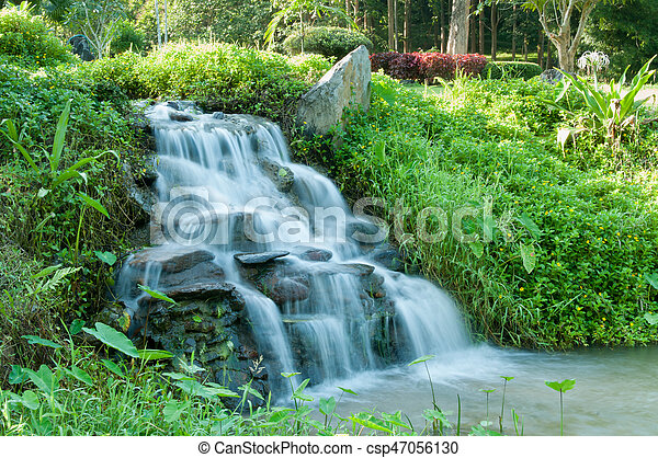 Closeup of small waterfall in the garden decorated - csp47056130