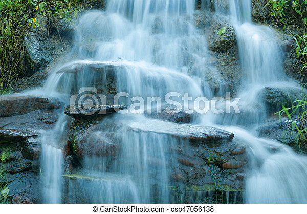 Closeup of small waterfall in the garden decorated - csp47056138