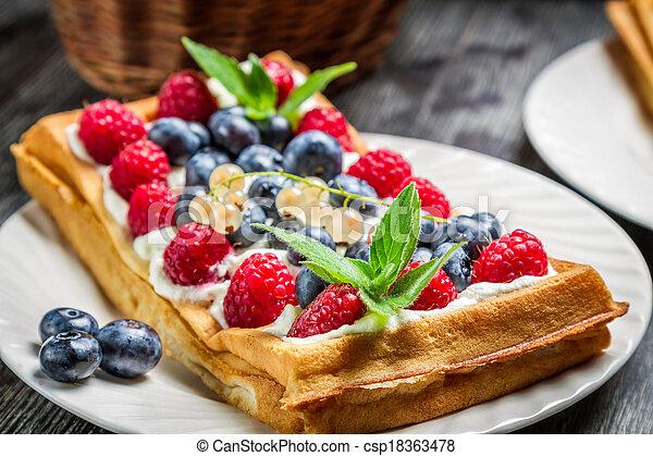 Closeup of waffles with fresh berry fruit - csp18363478