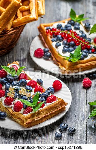 Closeup of waffles with fresh berry fruit - csp15271296