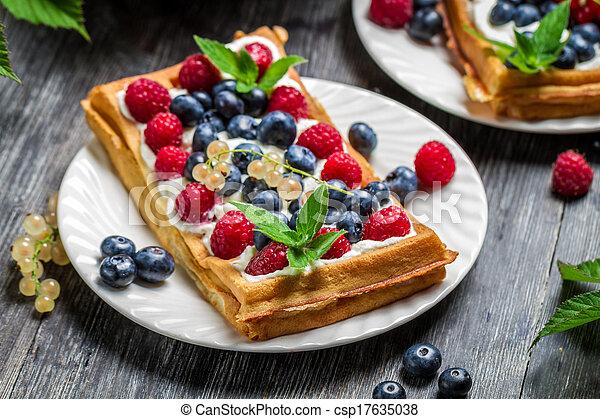 Closeup of waffles with fresh berry fruit - csp17635038